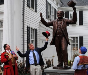 David Gesualdi, statue sculptor, poses with Ringling Bros. Barnum & Bailey clowns.