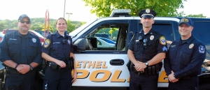 "Bethel Police stand in front of their SUV at National Night out, summer 2011. Bethel P.D. will host ""Stuff-a-Cruiser"" at Target on Sat. Dec. 8, 2012.  Come fill their SUV with toys for needy Bethel children. Photo credit: Wendy Mitchell"